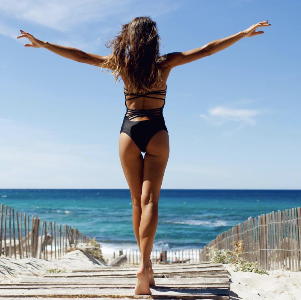 photo of bikini wearing woman going to beach in vancouver